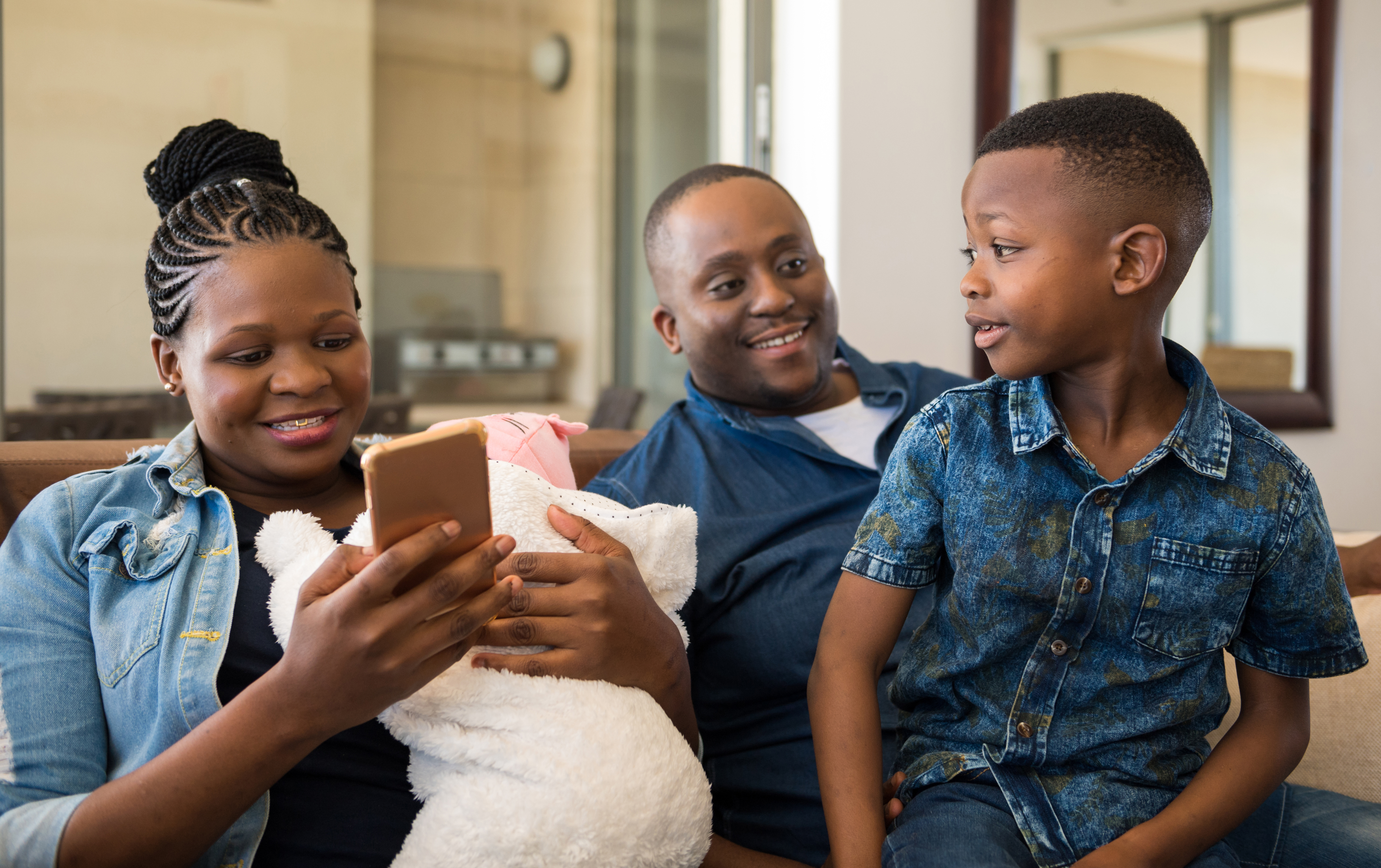 Woman using the app with her family at home